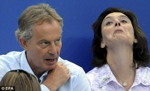 Tony Blair controls David Miliband, & Gordon Brown through his secret microphone, while Cherie practises her facial yoga